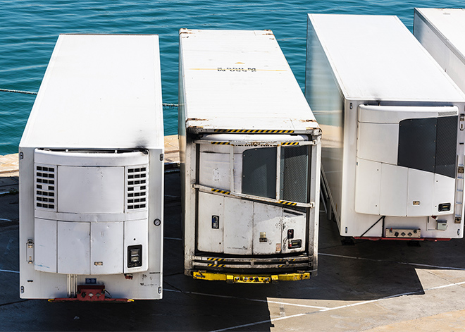 3 reefer trailers parked next to water