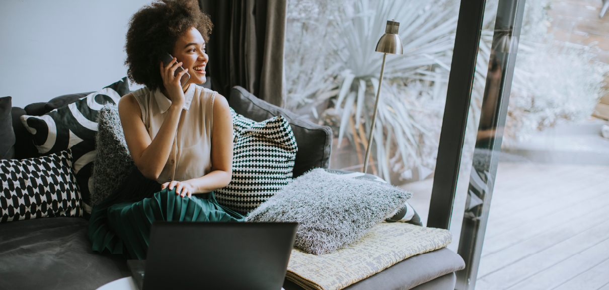 5 Reasons Why Independent Consulting Is on the Rise - Woman sitting on couch and working from home on the phone