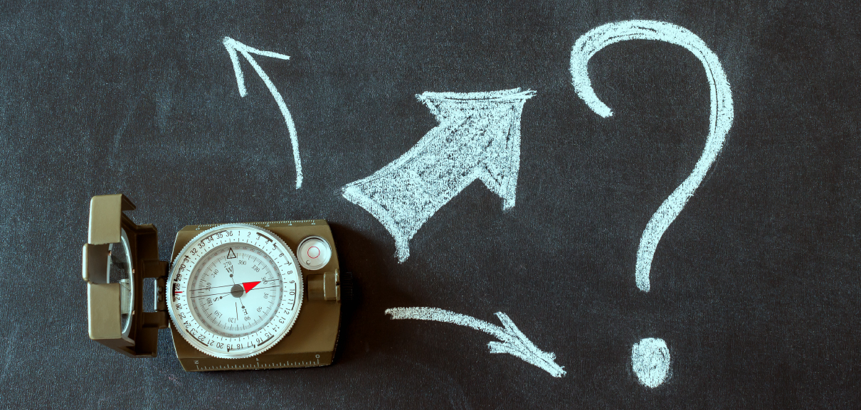 Navigating Uncertainty with FutureCasting - Image of compass with chalk arrows coming out of it