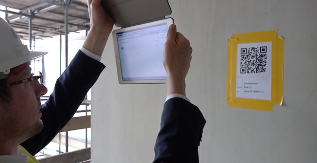 Managers uses construction technology on their iPads for safety checks