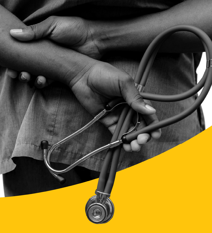 Hands crossed behind person's back and holding a stethoscope.