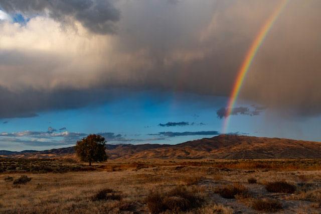 rainbow in deserted landscape
