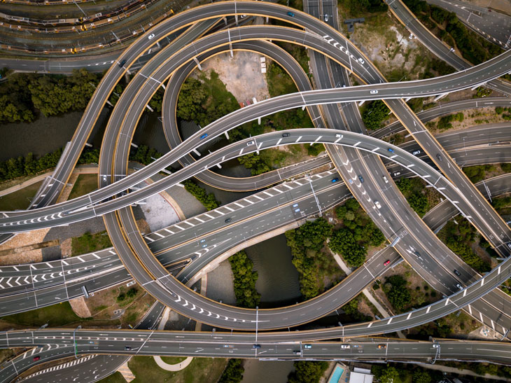 aerial view of highway with vehicles driving