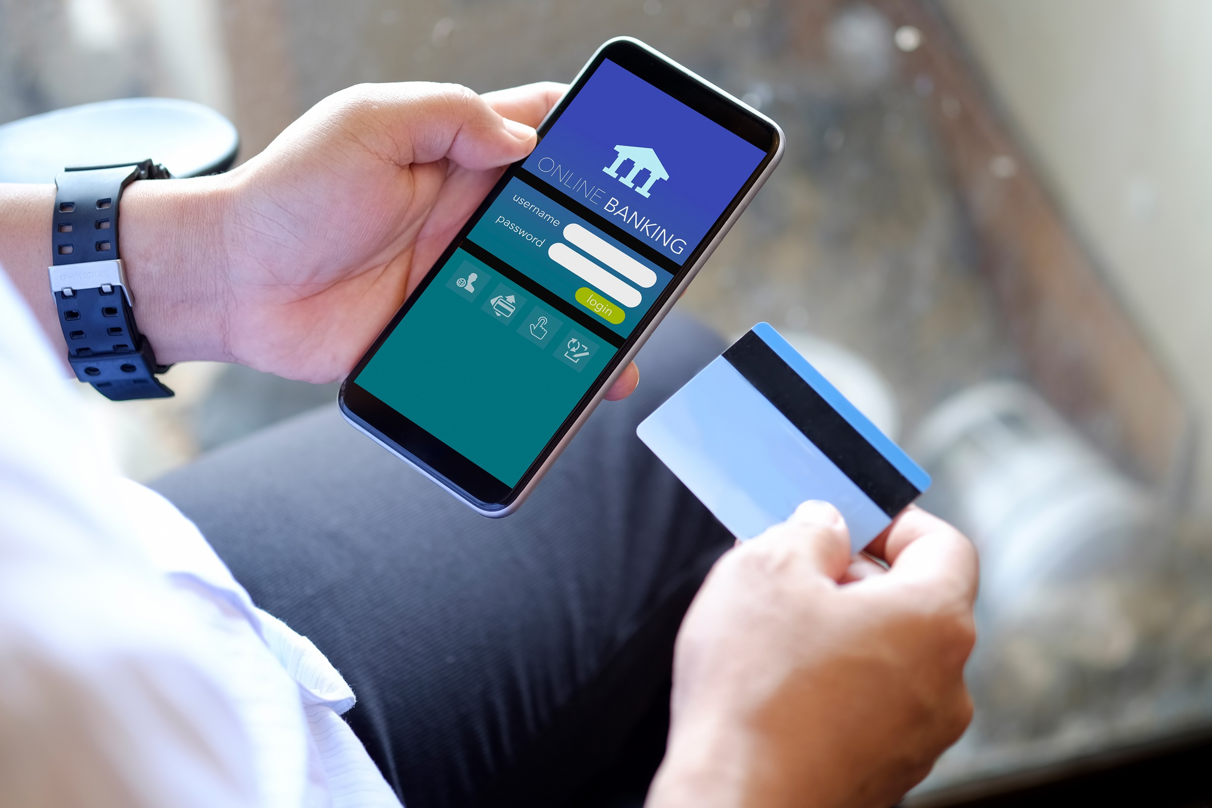 Man using online banking app on mobile phone for online payment
