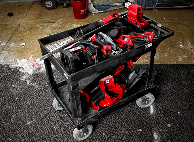 A cart of construction tools on a jobsite should be properly cleaned