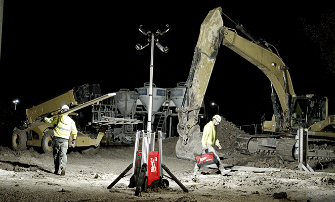 A jobsite, where tradesmen are at work, at dark, illuminated by a Milwaukee rocket tower light