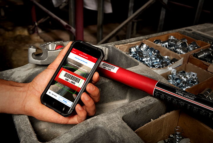 smartphone camera scans barcode on a hand tool