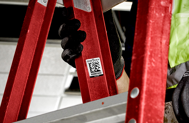 red ladder is tagged with an identification sticker