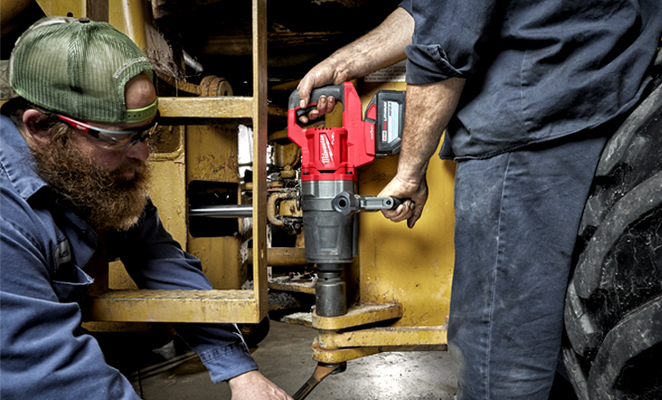 Image shows two men tradesmen on jobsite completing work with Milwaukee d-handle high torque impact wrench