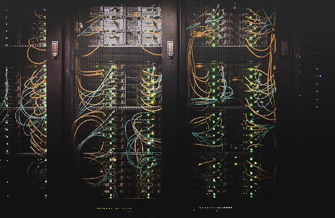Computer server hardware is caged behind locked doors