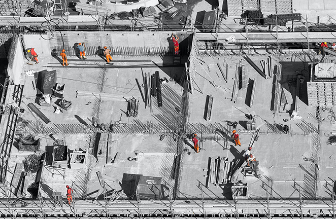 Aerial view of construction workers on jobsite