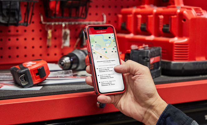 A tool room manager operates One-Key inventory management app on smartphone to review tool location history