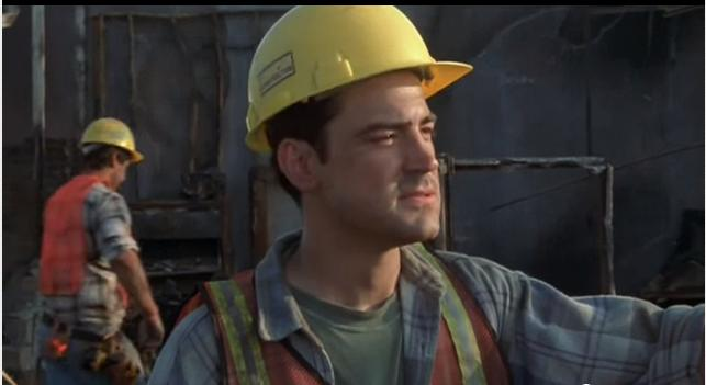 Peter Gibbons from Mike Judge's 1999 Office Space on construction site in high visibility vest and yellow hard hat