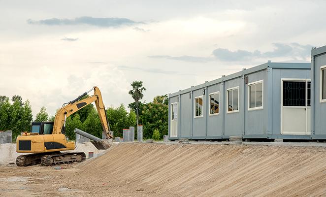 A crane beside temporary classroom buildings
