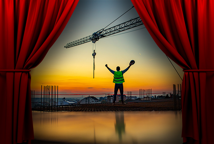 Movie curtains open to show construction worker with arms outstretched