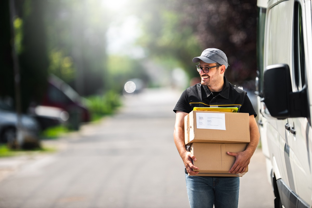 Delivery man with subscription box for customer