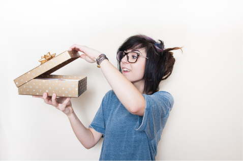 A girl looking inside a subscription box | RRD