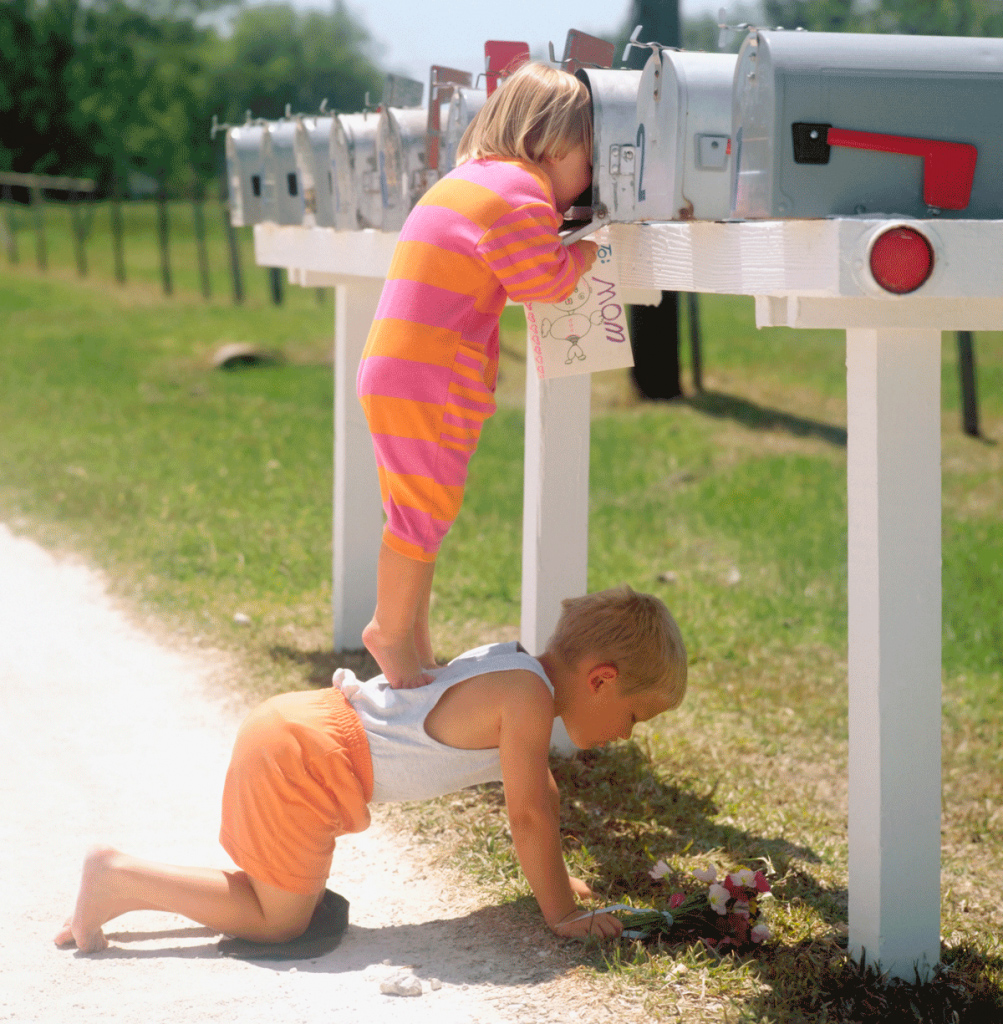 Child checking the mailbox for a direct mail marketing piece from RRD