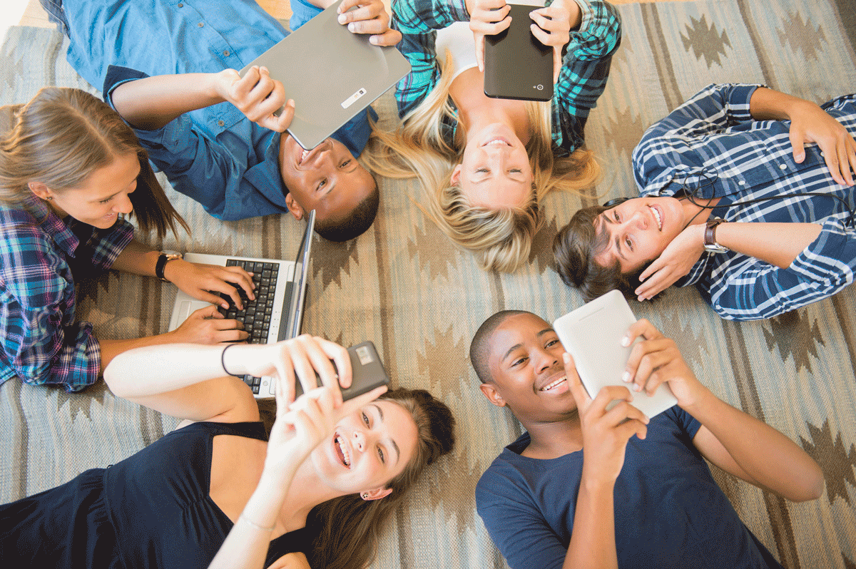 Teens on phones - marketing to generation Z requires a multichannel approach.
