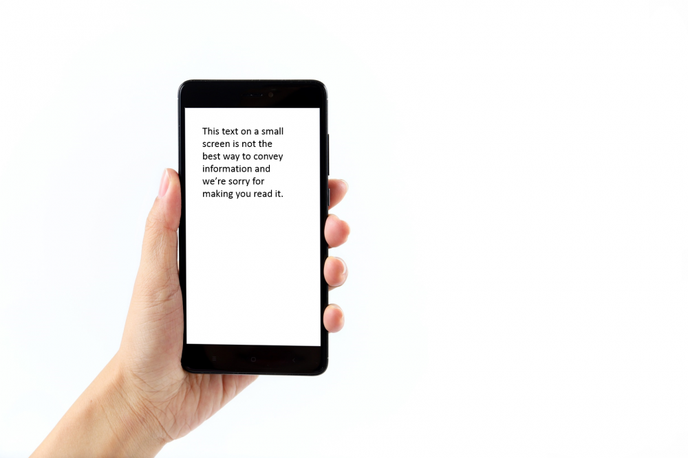 image of a hand holding a cellphone with small text on the screen as an example of keeping imagery and text separate when it comes to marketing materials
