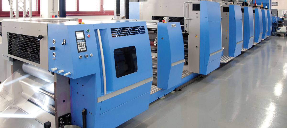row of large blue and silver commercial print machines
