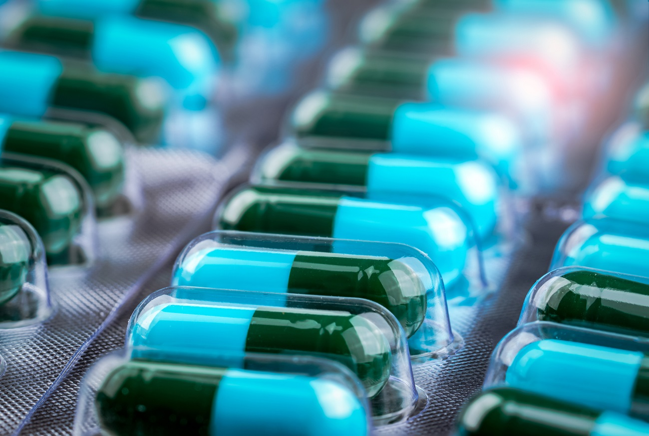 tray of blue-green medication capsules