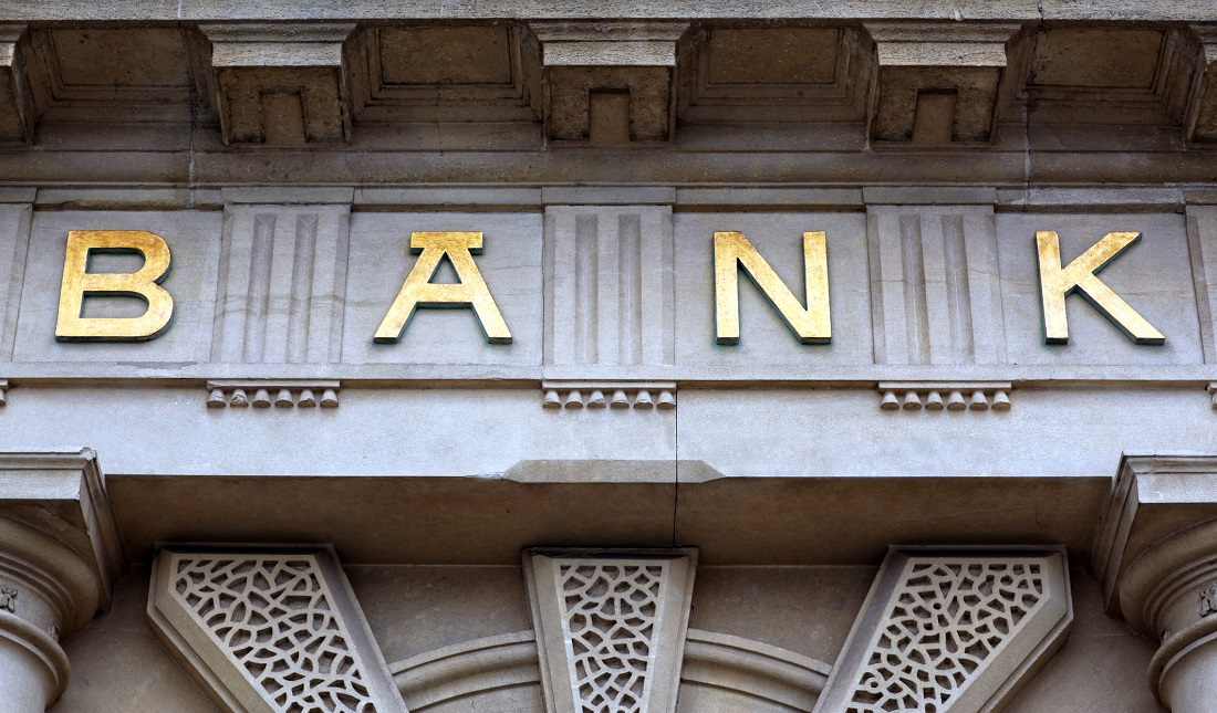 The word bank in gold on the front of a building