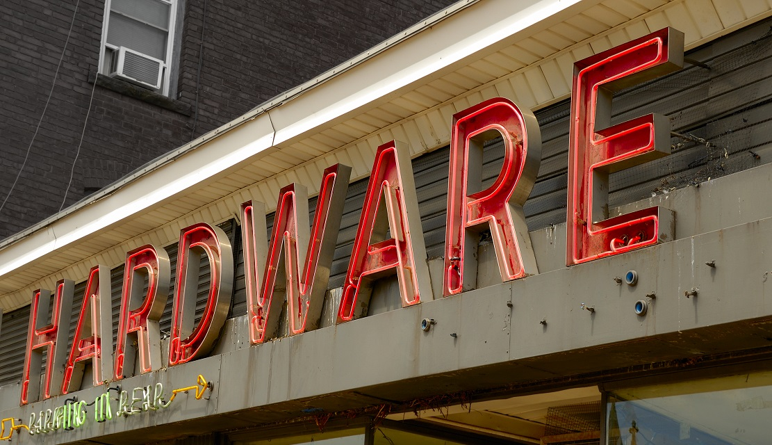 neon hardware store sign