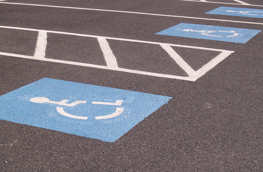 Blue handicap parking markers in parking lot spaces