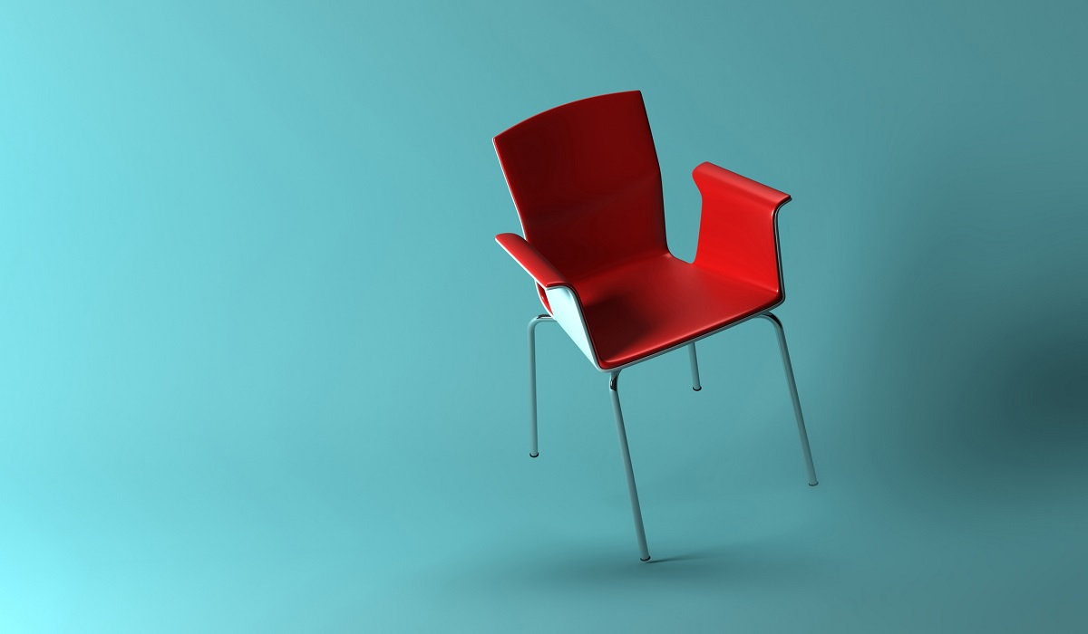 3D rendering of red armchair balancing on one leg with a turquoise backdrop tur