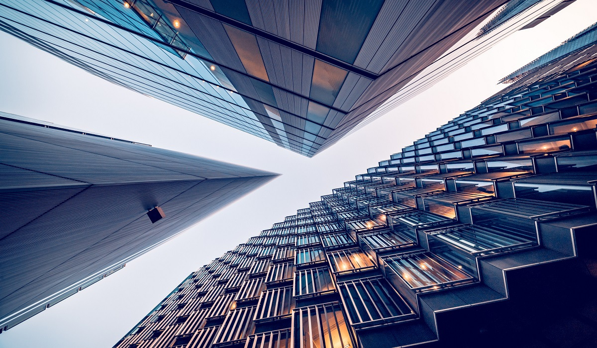 Looking directly up at the skyline of the financial district in central London