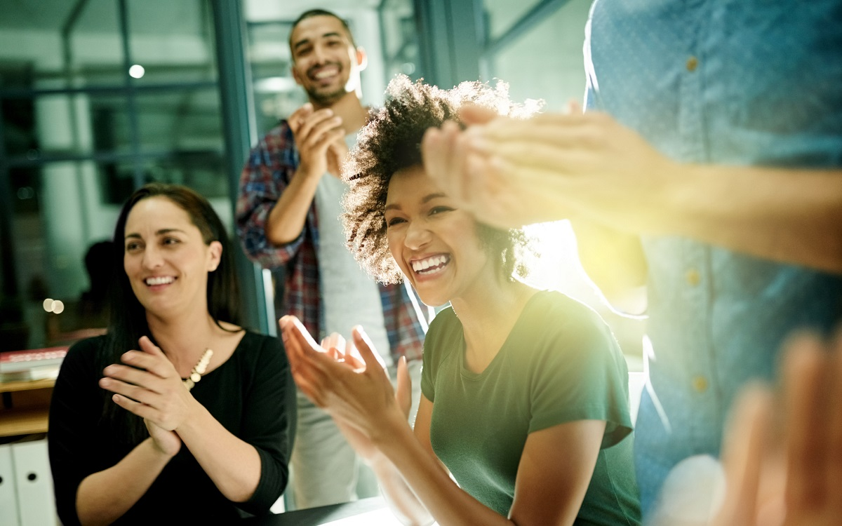 Shot of a team of creative and diverse businesspeople applauding an achievement while working late in the boardroom