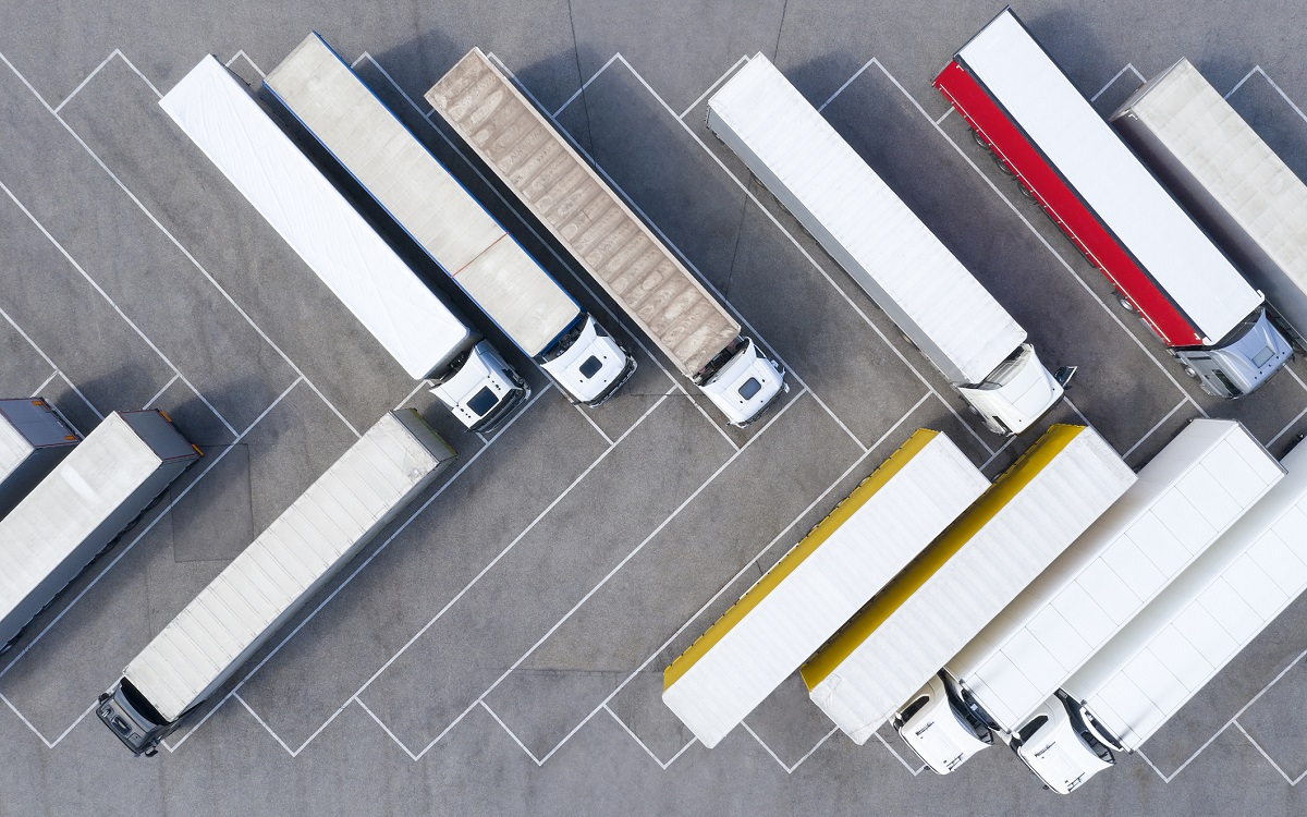 Large Group of Trucks at Truck Stop, Aerial View