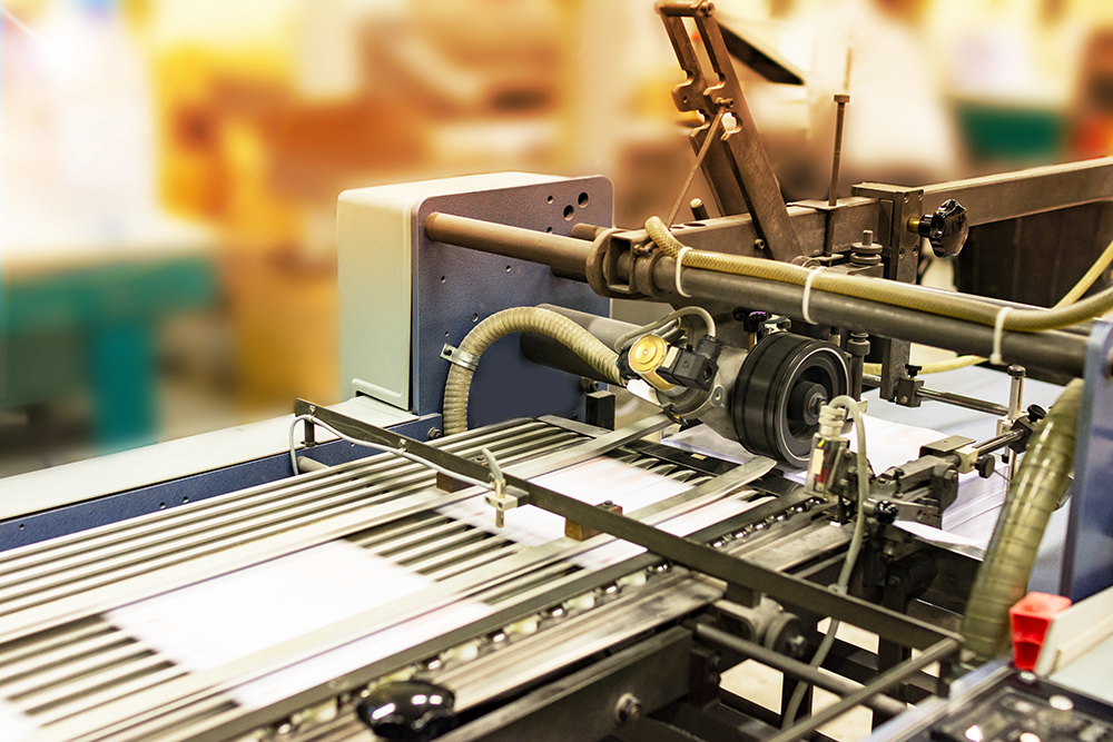 Pages being printed on printing press