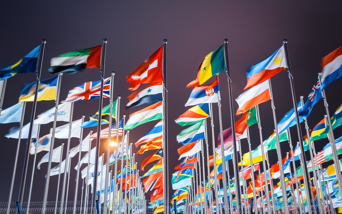 Rows of flagpoles flying world national flags