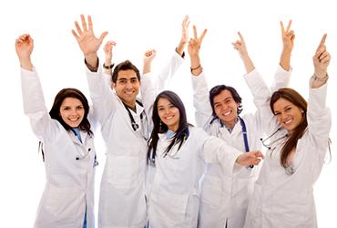 Five happy doctors with hands raised