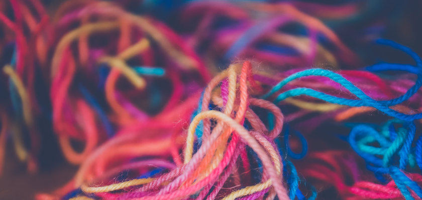 This photo shows a tangled, multicolored mass of yarn that symbolizes the messiness and confusing that surrounds content strategy as a discipline.