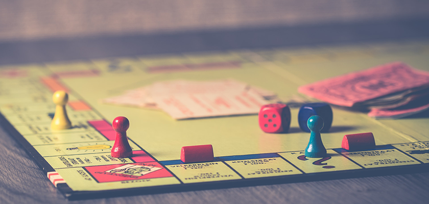 A photo of a Monopoly board symbolizes the need to accumulate money to invest in content marketing.
