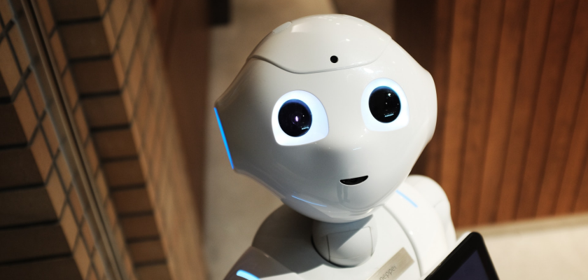 Photo of an artificial intelligence robot looking into the camera symbolizes the future of marketing technology.