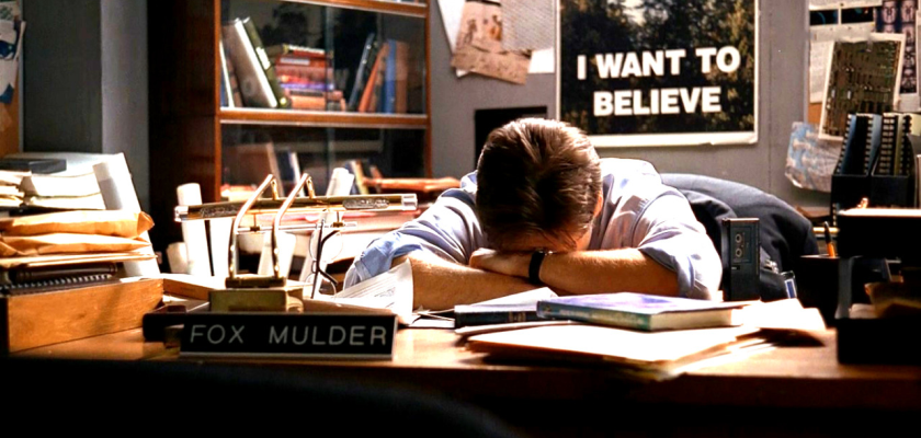 "A photo from the X-Files shows agent Mulder in his office with an ""I Want to Believe"" poster on the wall."