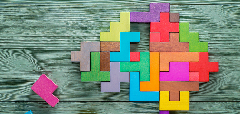 Combined martech and content creativity concept with a human brain made of multi-colored wooden blocks