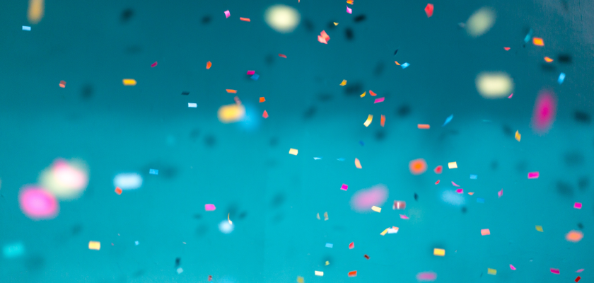 A burst of multicolored confetti against a blue background represents the celebration of a Killer Content award for DemandLab.