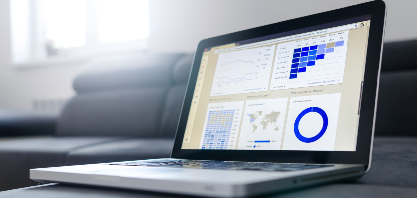 A laptop with a marketing analytics dashboard represents the digital marketing expertise of the Marketo Champions on DemandLab's team.