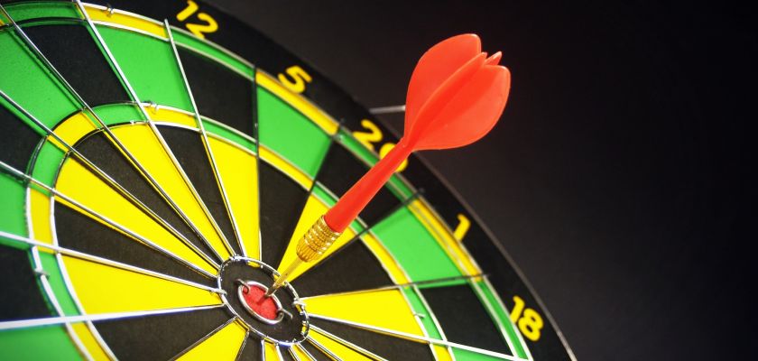 A close-up of a bullseye with a dart in the center represents DemandLab's win.
