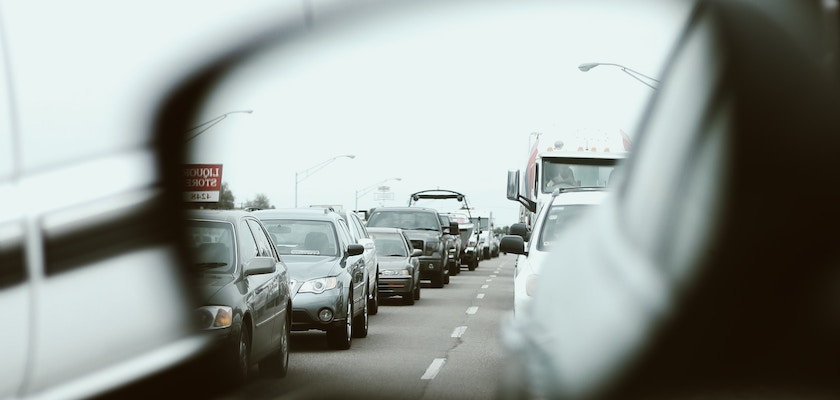 Rearview mirror view of a congested highway of traffic