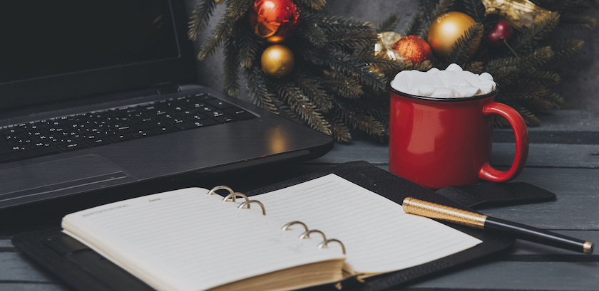 Festive desk decor for marketer who is planning workload during holidays