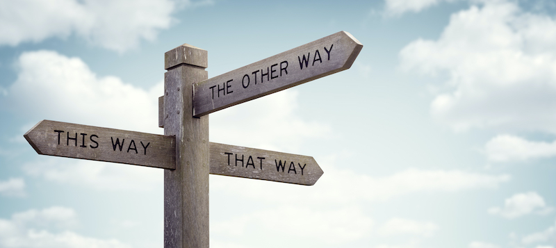 "A signpost includes directions to ""This Way,"" ""That Way,"" and ""The Other Way,"" symbolizing the confusion that can happen when content isn't tagged."