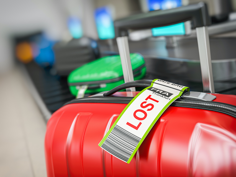 "A red suitcase with a ""lost luggage"" label sits in front of a luggage carousel, symbolizing the importance of tagging content so that it doesn't end up lost."
