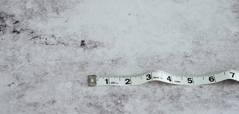 Measuring tape on gray marble background to measure revenue attribution