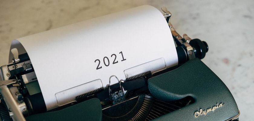 "Green typewriter with ""2021"" on a piece of paper"